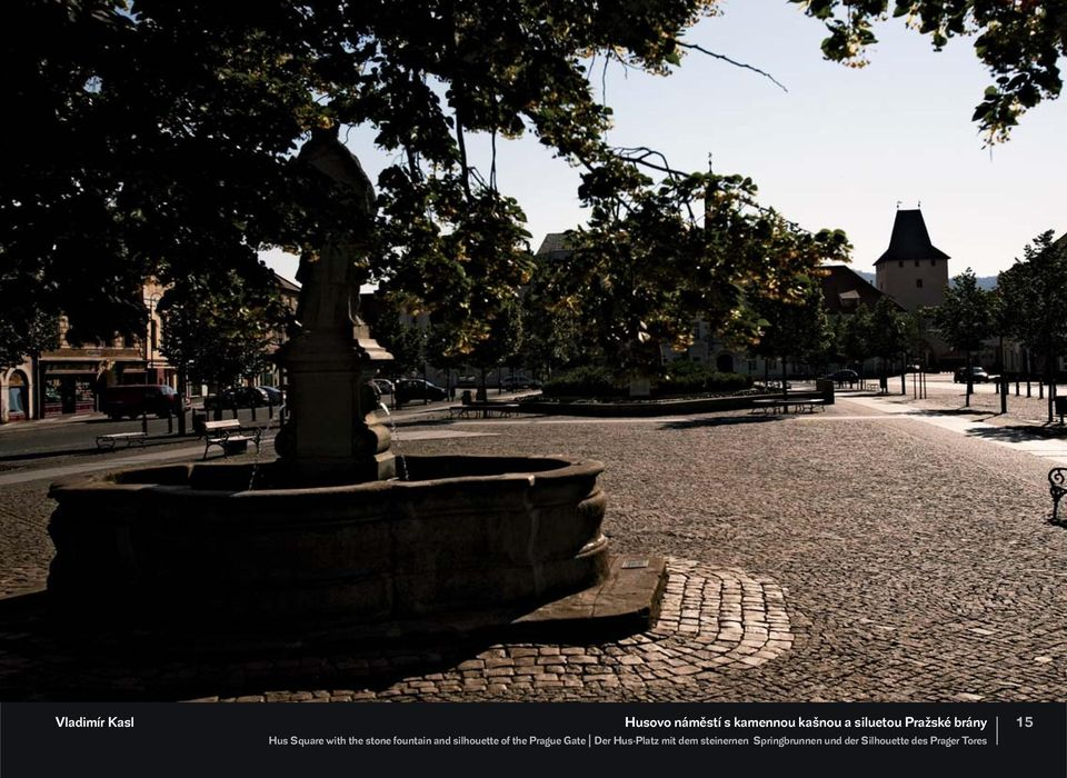 fountain and silhouette of the Prague Gate Der Hus-Platz